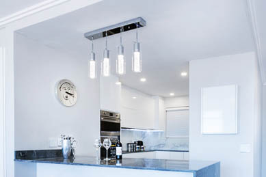 This picture shows track lighting installation in Ventura. The tracks lights were installed over the kitchen island.
