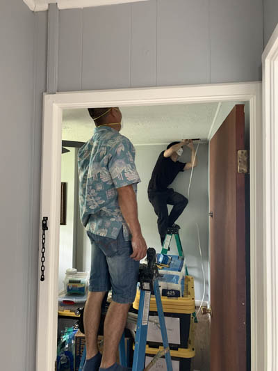this picture shows an electrician rewiring a house in Ventura